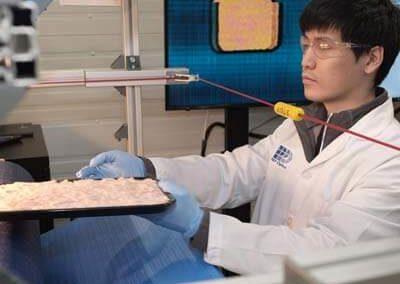 Image of Qianshiu putting pork through PPO's System