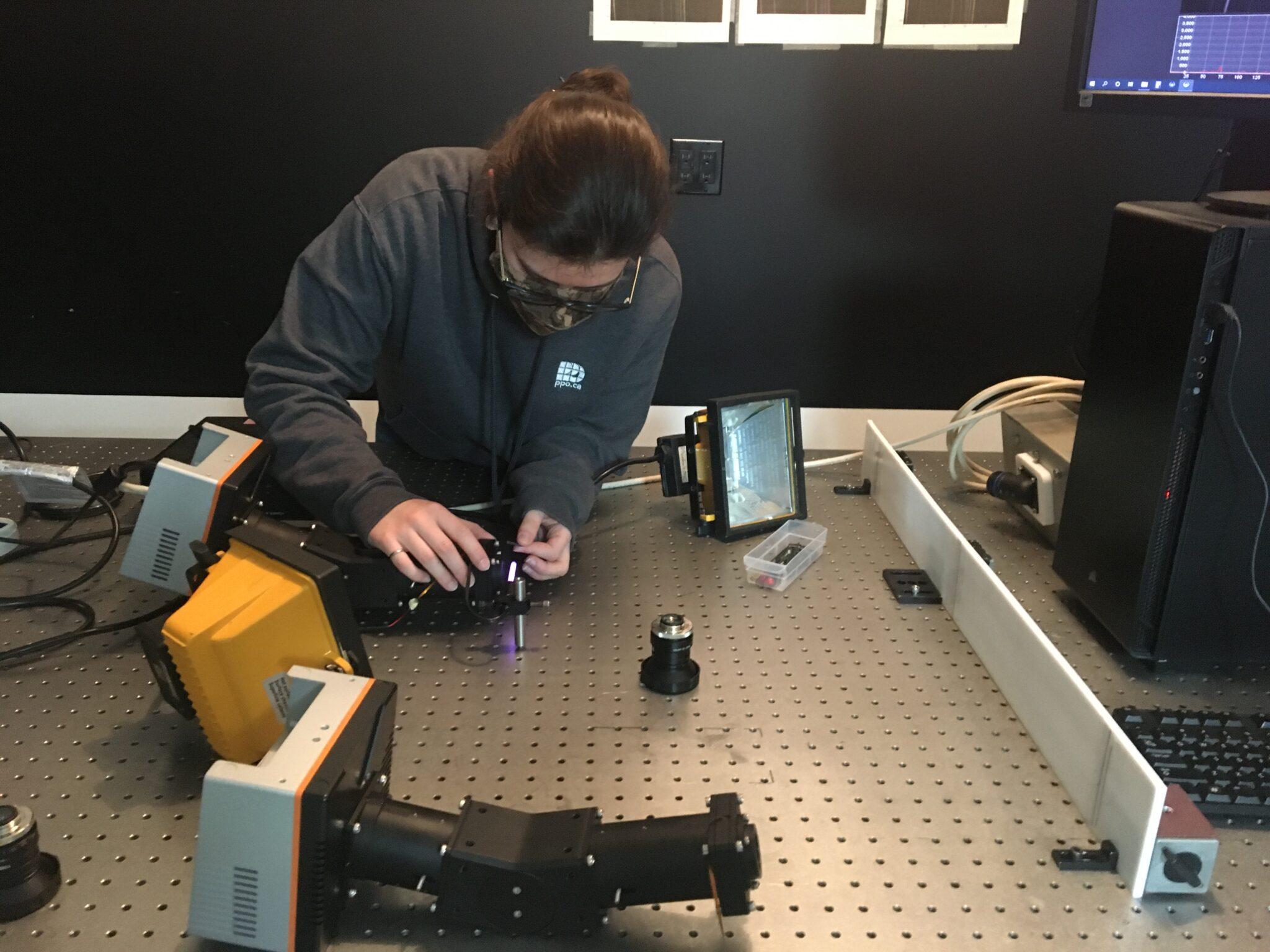 Staff working on spectrometer
