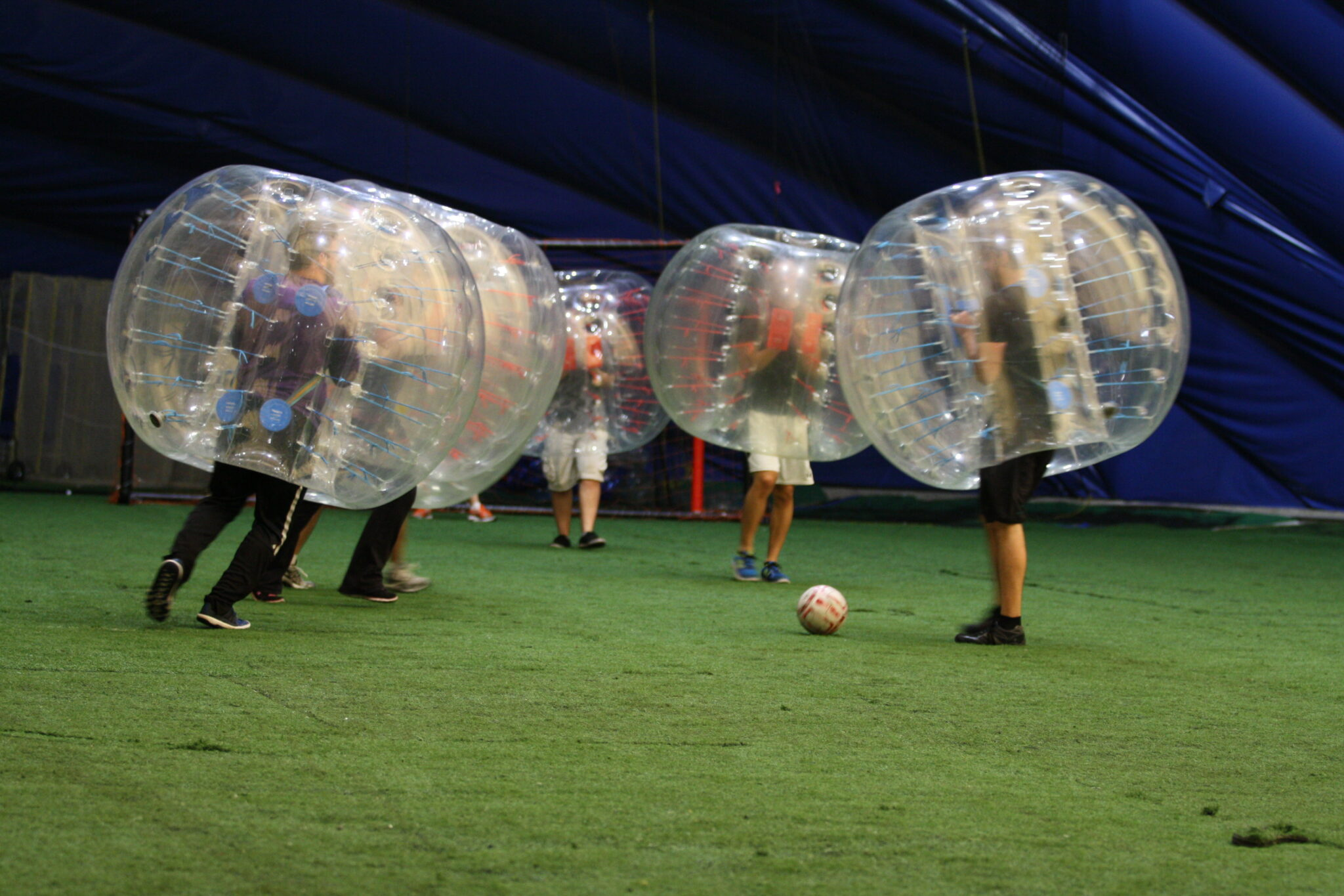 Team playing bubble soccer